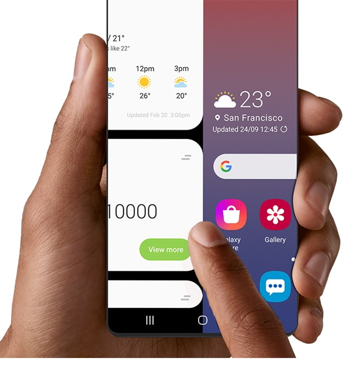 An image of a smartphone held in a hand and swiping right from home screen to a view of Bixby Home.