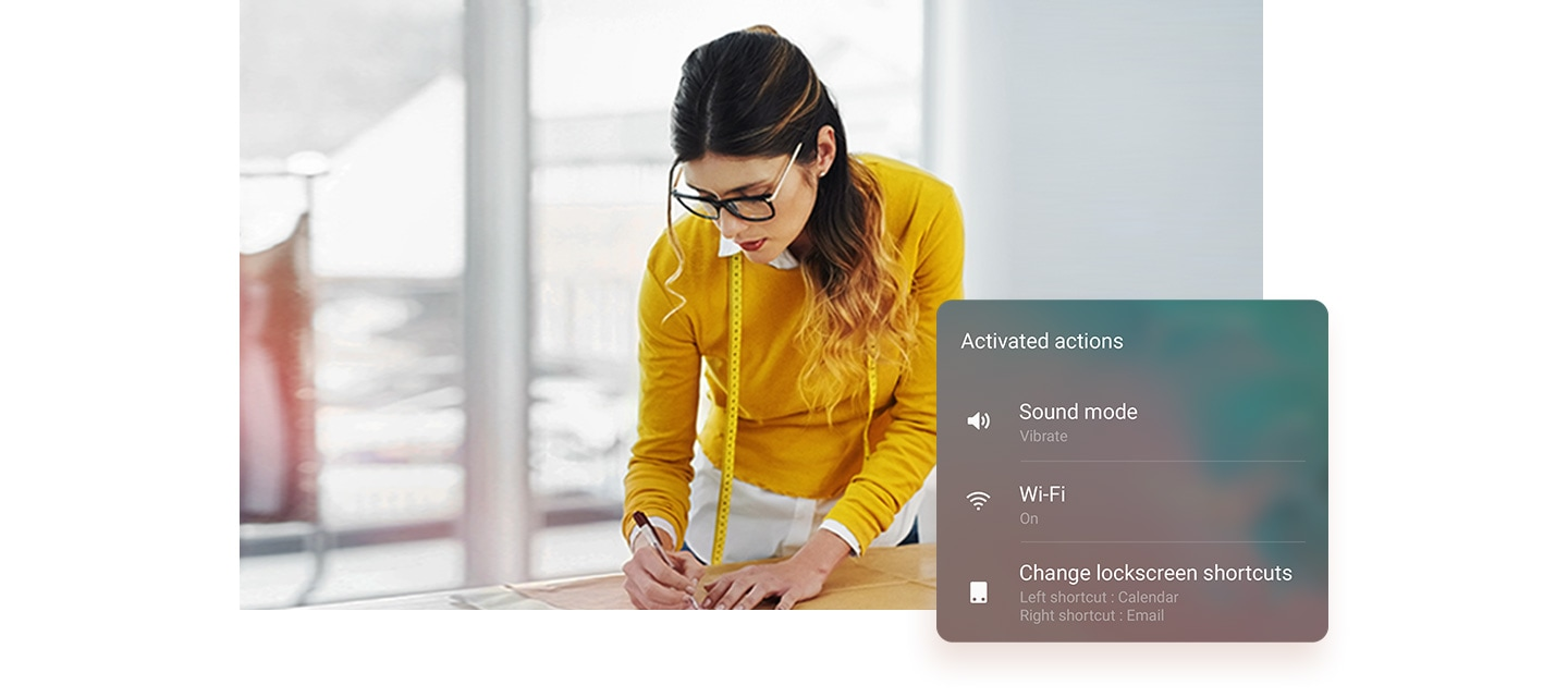 Image of woman measuring a pattern in her office. On the side is the Activated actions window and it says Sound mode vibrate, Wi-Fi on, and Change lock screen shortcuts to Left shortcut: Calendar and Right shortcut: Email