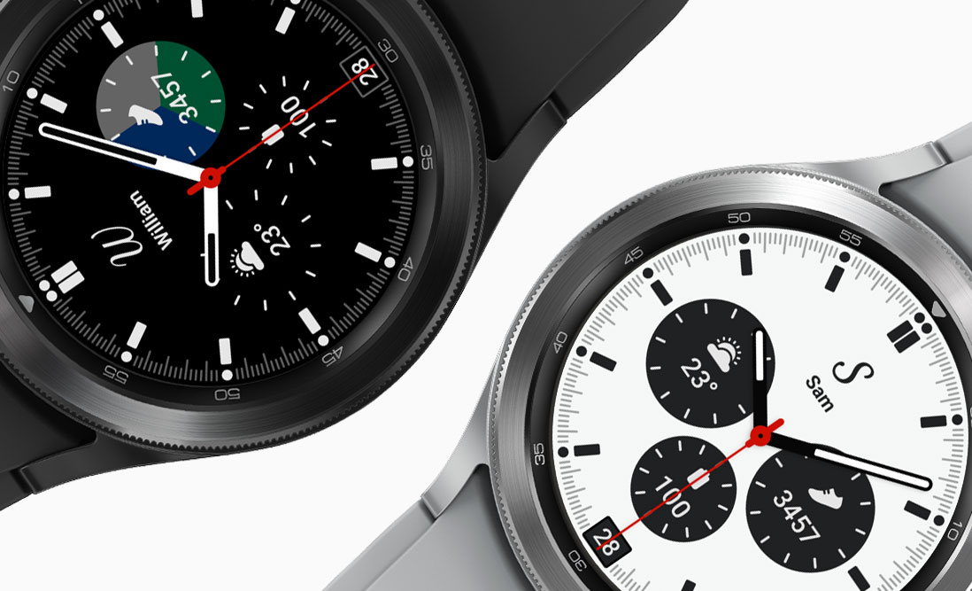 Two watch faces of the Galaxy Watch4 Classic is shown black on the left and silver on the right The watch faces are both displaying the time