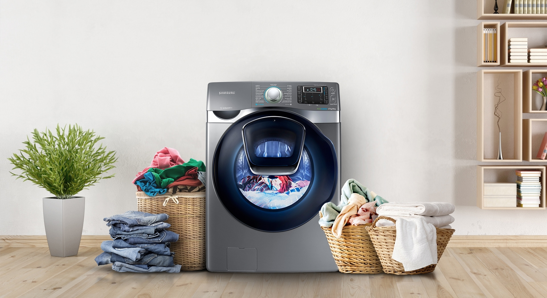 An image showing the WD9500K Add Wash in a room in a house. Beside it are three baskets full of laundry and a pile of folded clothes.