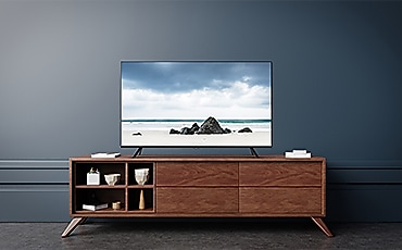 A woman is watching TV.