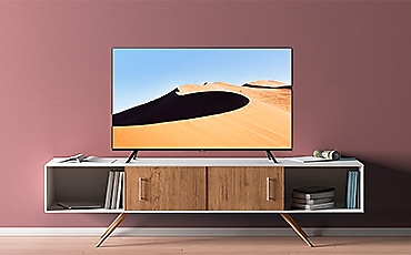 A man is watching TV.