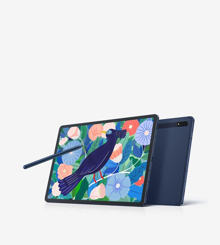 Angled view of Galaxy Tab S7+ propped up with the Book Cover Keyboard. The keyboard is detached underneath. An S Pen is suspended in the air pointing at the screen. The screen shows a vivid illustration of a bird among leaves and flowers.