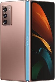 Galaxy Z Fold2 in Mystic Bronze with Metallic Blue hinge, seen from the rear slightly unfolded with the butterfly wallpaper on the Cover Screen.