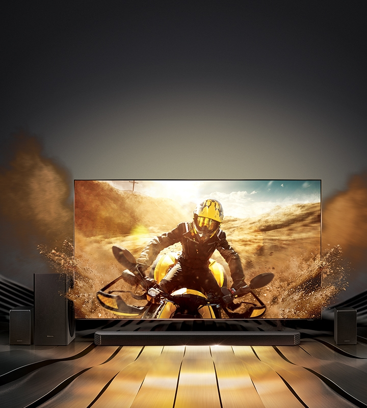 """New 2020 Samsung Q950T soundbar and QLED TV are placed together showing dynamic motocycle scene on the screen"""