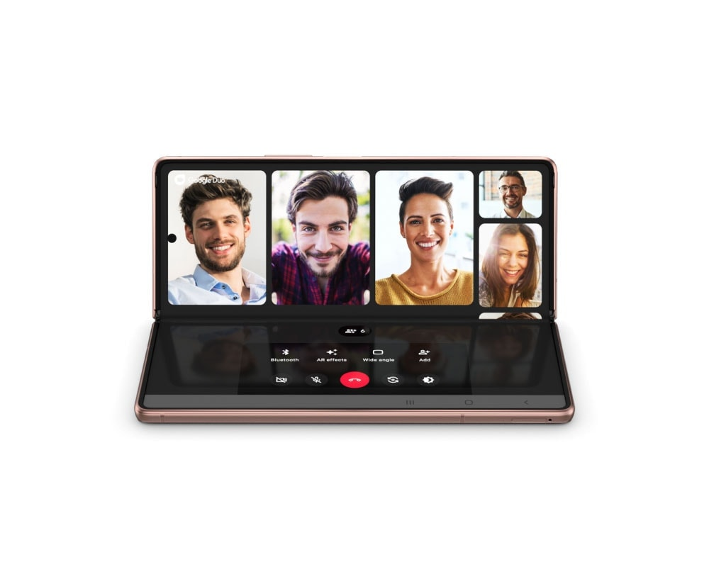 Galaxy Z Fold2 in Mystic Bronze, seen folded and from the rear. It turns counter clockwise, unfolding as it turns until it's facing forward with the Main Screen revealed in Flex mode. Onscreen is a Google Duo video call with 5 participants, demonstrating how Flex mode splits the screen in half with the viewing area on top and the controls on the bottom.