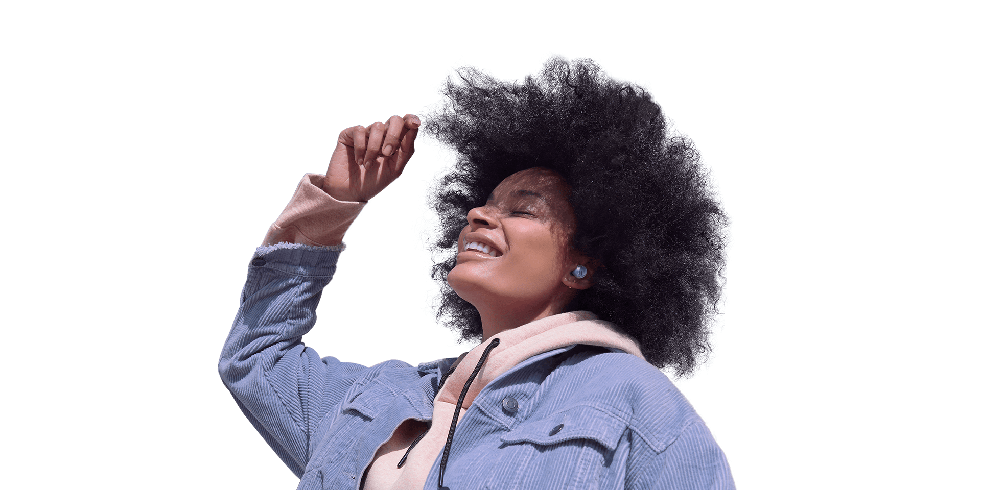 A woman wearing Galaxy Buds Pro. She is dancing and clearly enjoying the music she's listening to. Rings appear around her, expanding until the background is blocked, to represent the noise blocking that Intelligent ANC delivers.