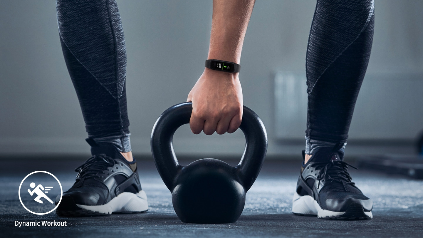 Lifting weights shows a person wearing the Galaxy Fit2 on their wrist. You can see the workout symbol at the bottom of the picture.