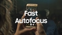 Woman watching How-to fast autofocus video on Galaxy S7 edge