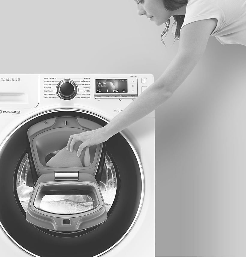 An image showing a woman adding an item to the wash via the Add Door.