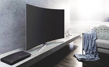 see large image of left perspective image of TV in a bedroom.