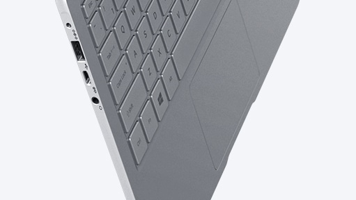 An image showing a silver Notebook 9 device's side, with its keyboard showing, suspended in mid-air, against a white backdrop.