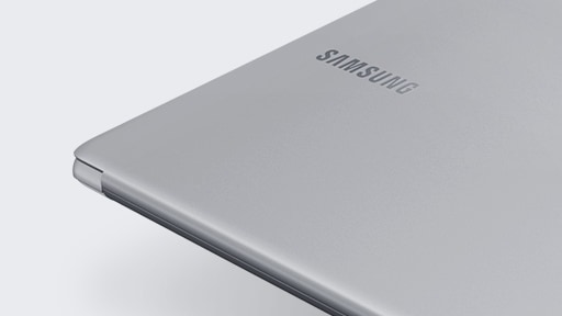 A magnified image of the left side of the Notebook 9 device's bottom part, with its cover showing, open fully, with the Samsung logo visible.