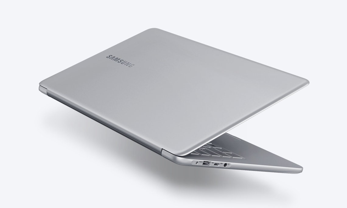A image of the left side of the Notebook 9 device's bottom part, with its cover showing, partially open, with the Samsung logo visible.