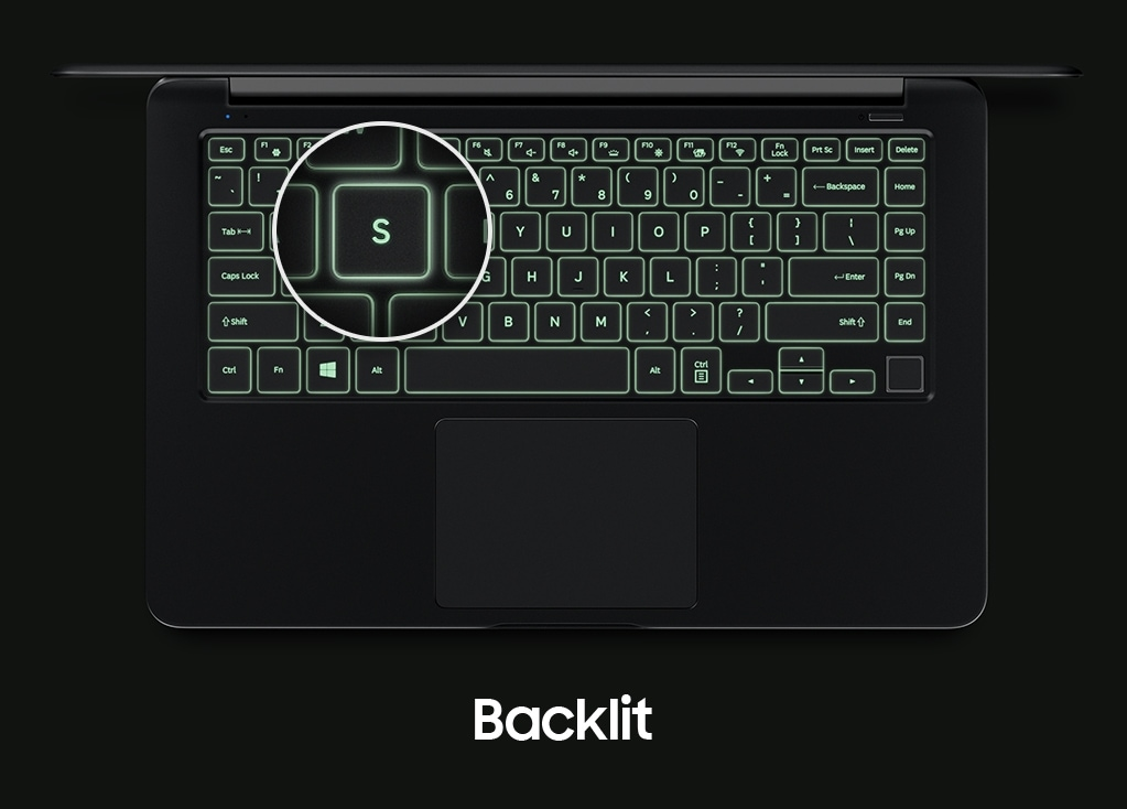 "An image showing a top view of the Notebook 9's cover open, with a backlit keyboard and a magnified image of its ""S"" key."