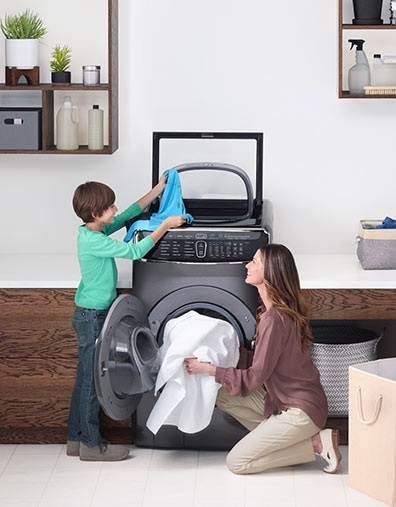 3. A mother and her son use the FlexWash in the laundry room.