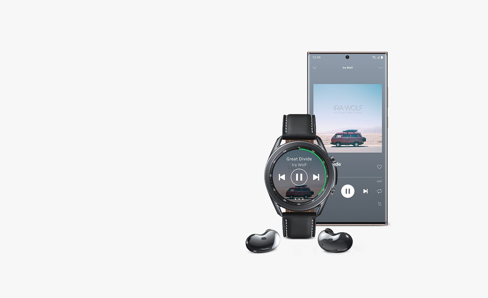 Front view of 45mm Galaxy Watch3 in Mystic Black next to a Galaxy smartphone and Galaxy Buds Live. The watch and smartphone display the same Spotify GUI, showing how you can play music on Galaxy Buds Live and seamlessly control it through Galaxy Watch3.