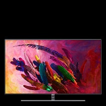 A front view of silver Samsung QLED TV on a stand with red, green, orange, and purple colored image applied as on screen image.