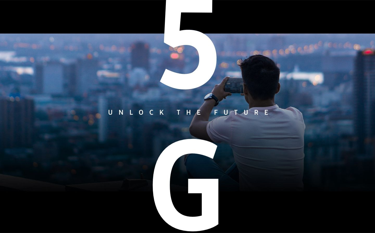 Man taking a photo of a cityscape with his Galaxy 5G smartphone. Overlaid on the image is text that says 5G unlock the future