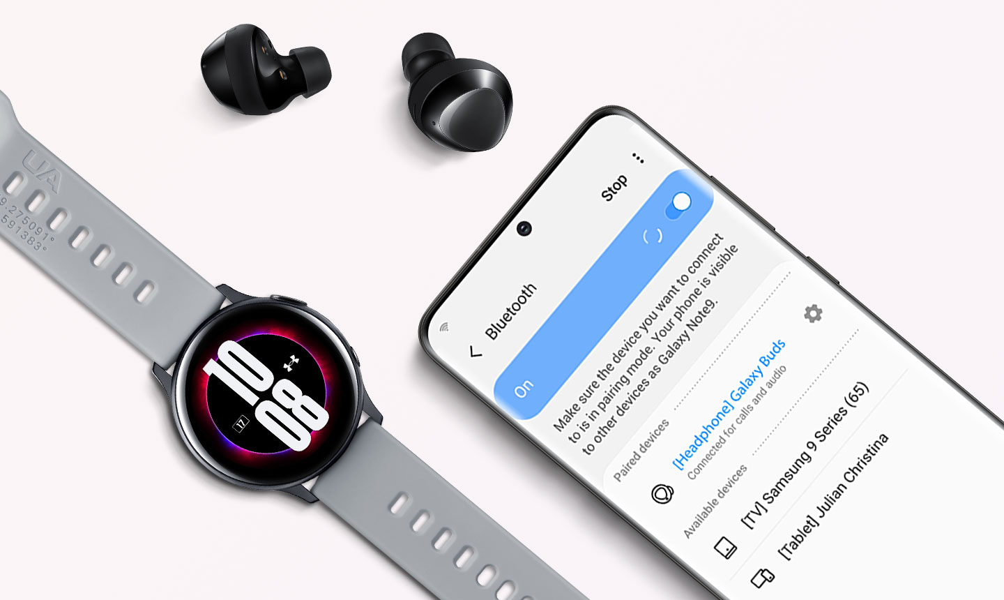 Black Galaxy Buds plus next to compatible Galaxy devices, with a phone displaying the Bluetooth pairing screen and a watch showing the time.