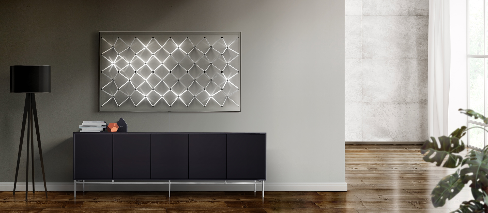 Ambient mode of Samsung's new QLED TV displays new contents in a light grid pattern to offer a fitting addition to the wall decor in the living room.