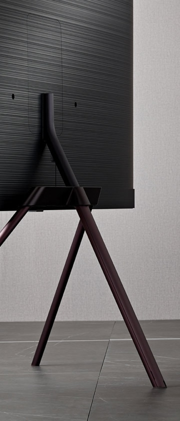 A back view of the QLED TV with the Studio Stand.