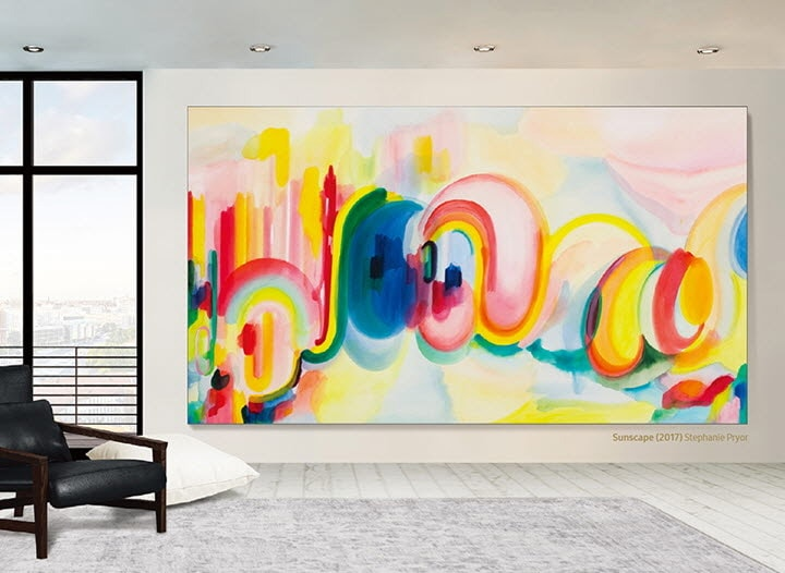A simple living room environment with The Wall displaying an art piece