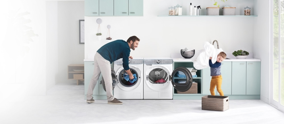 Better Together Washer and Dryer with Father and Son doing laundry
