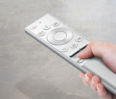 A 2019 Samsung one remote with a hand holding it.