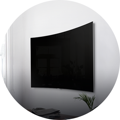 QLED TV is tightly close to the wall and hanging on it.