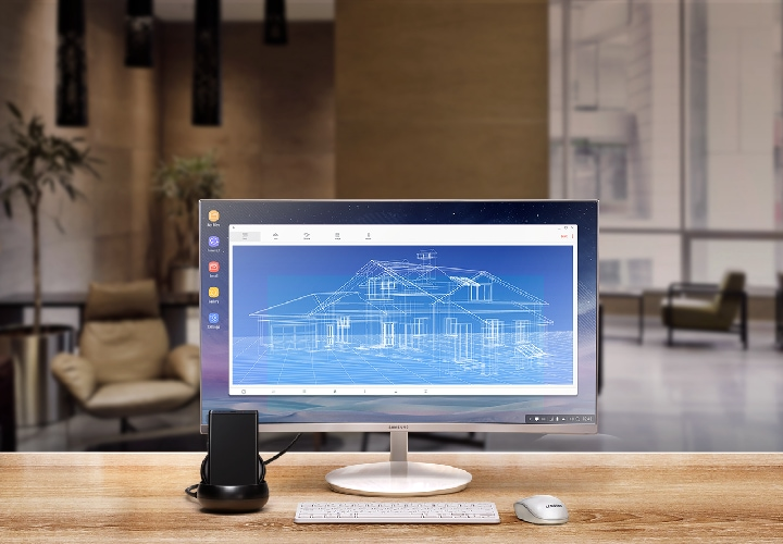 Image of Galaxy Note8, Samsung DeX station, monitor, keyboard, and mouse set up in a hotel lounge