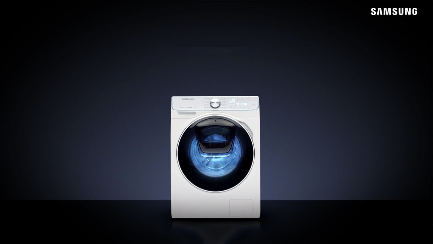 A Washing machine with QuickDrive in a dark room