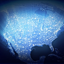 An illustrative image of a glowing light over a North America map.