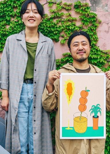 Kimi and Iri displaying their digital illustration outside their studio and home.