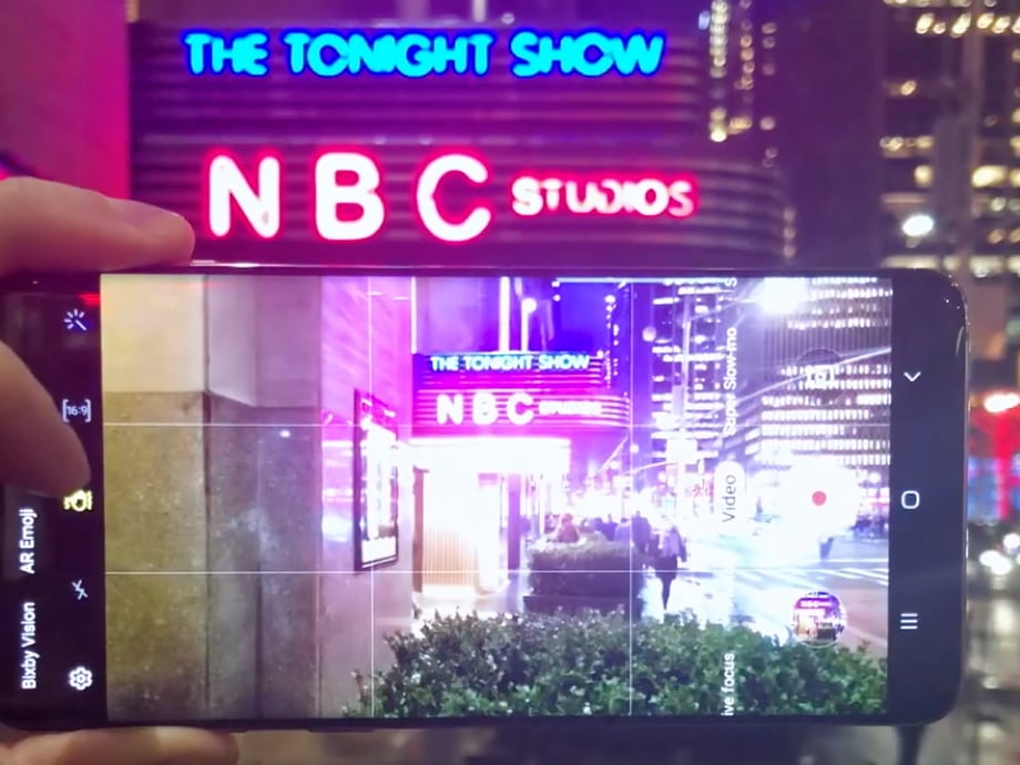Red and blue neon marquee of NBC Studios/The Tonight Show at the GE Building in New York City captured on a Samsung Galaxy S10+ smartphone.