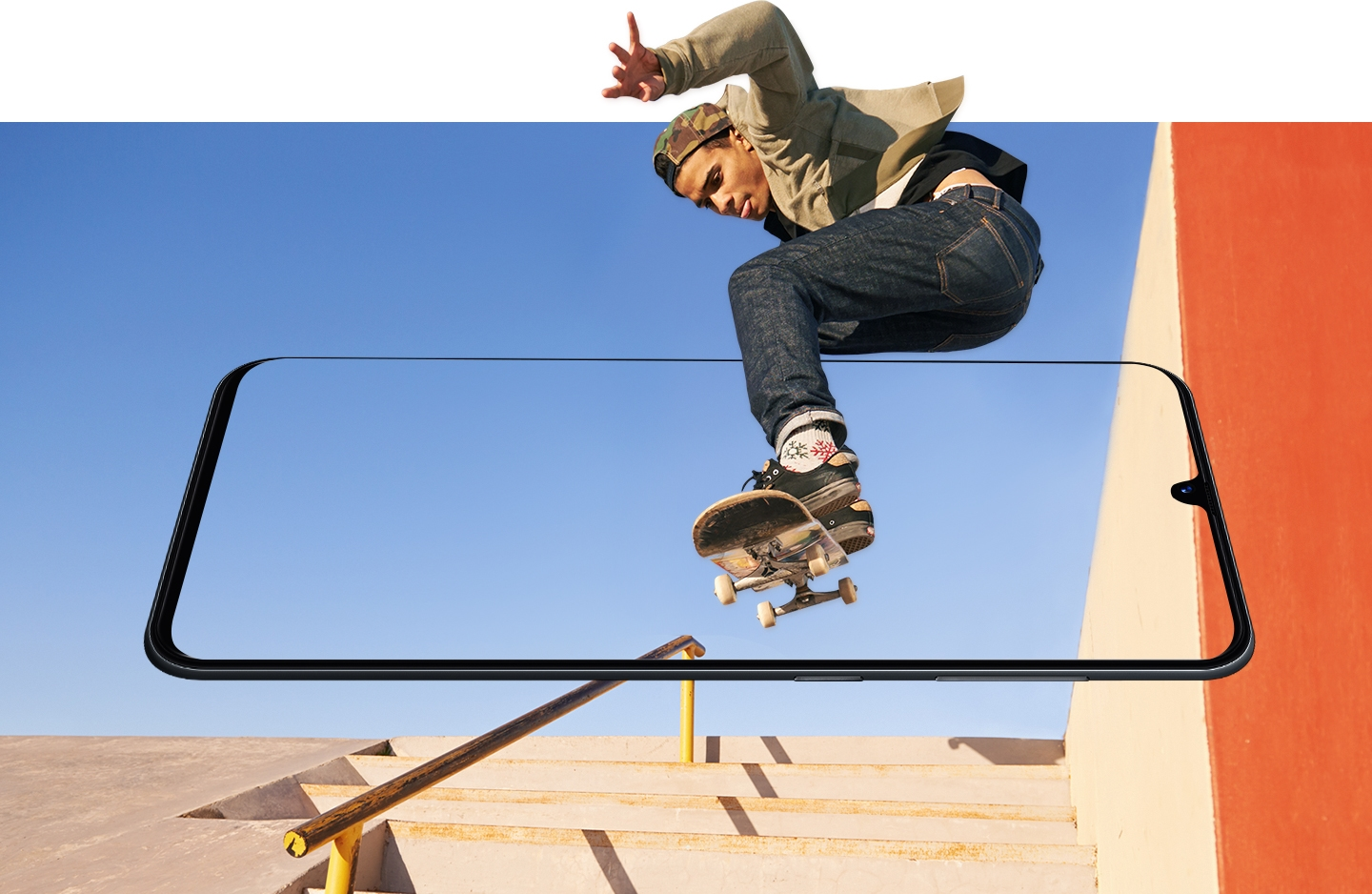 Simulated image of Galaxy A tilted forward and blending in with the skatepark background as a skateboarder jumps mid-air to show how the screen brings everything to life.
