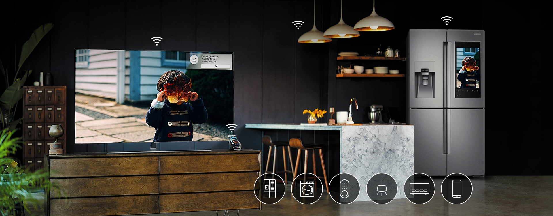 The Samsung QLED TV in the living room, mobile phone, and the refrigerator standing next to the kitchen table are connected with wi-fi to function together harmoniously. 6 icons are overlaid on image, representing possible connecting devices such as TV, door lock, refrigerator, washing machine, lightings and mobile phone.