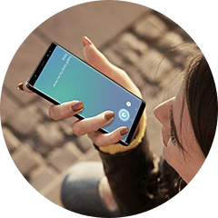 A Thumbnail image with woman commanding to mobile via Bixby.