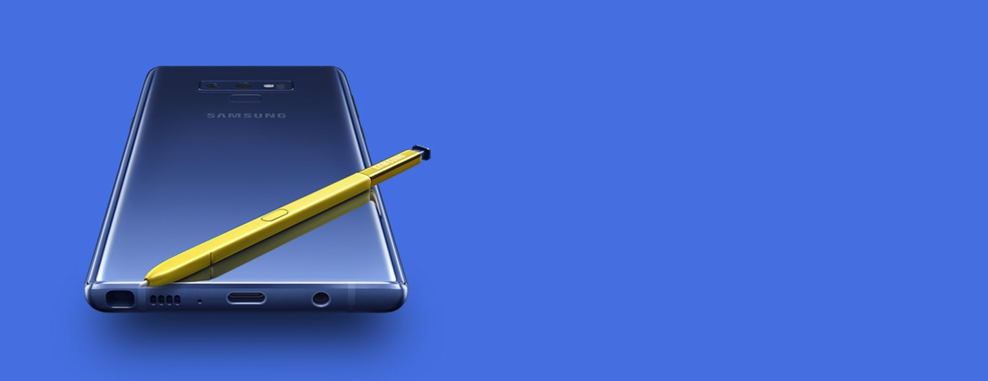 The rear of ocean blue Galaxy Note9 with yellow S Pen on top, viewed from the bottom
