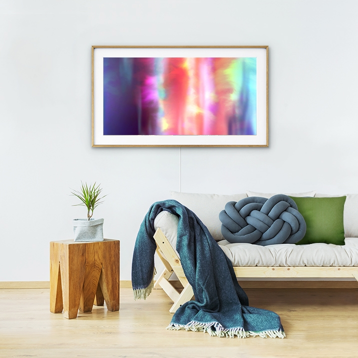 Samsung's The Frame on the wall displaying an art piece titled Aurore 01 by FIELD.