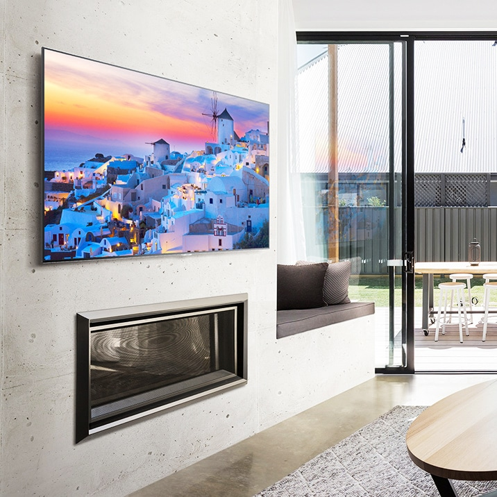 QLED TV hanging on the wall in a house.