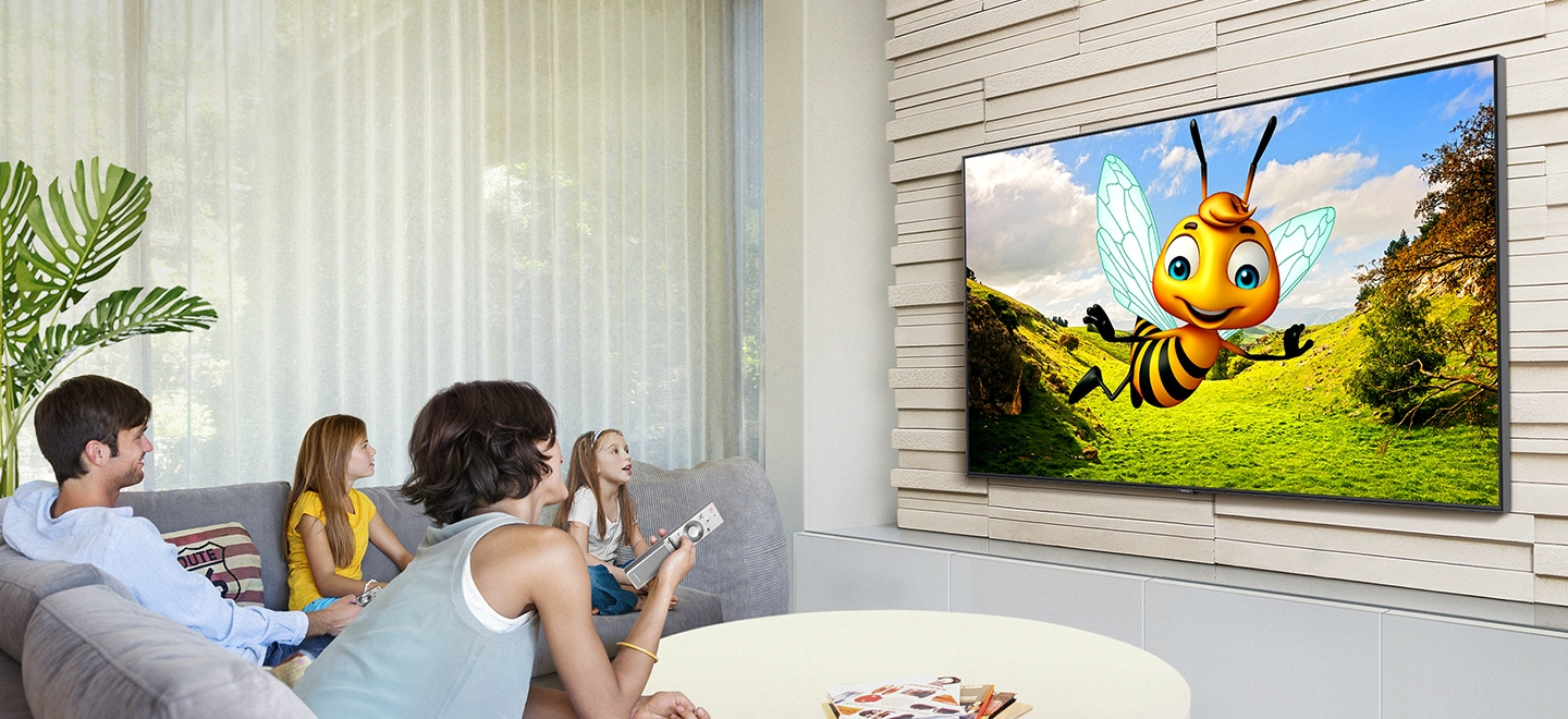 A family is watching YouTube  on Samsung Smart TV in the living room. The 3D animation with the bee character is being streamed through YouTube app on Smart TV.