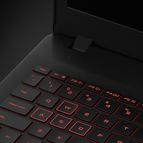 A magnified thumbnail image of part of a black Samsung Notebook Odyssey device's backlit keyboard