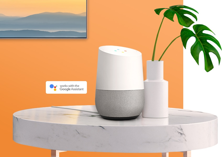 Google Assistant displayed on a white table, connected to a 2019 Samsung QLED TV.