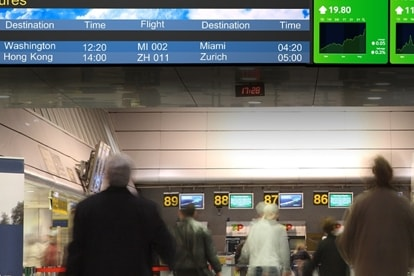 A wide display screen providing travelers various flight information