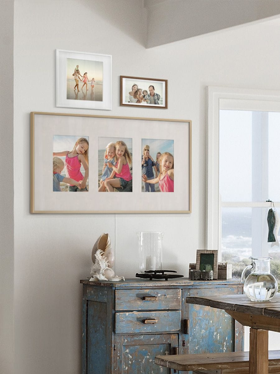 The Frame displaying three photographs in Squareslayout, hanging on the wall in dining room.