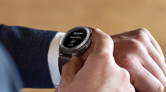 A man in a suit controlling his Samsung Gear