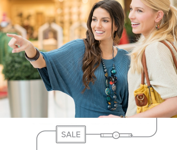 Two women shopping while wearing a Samsung Gear