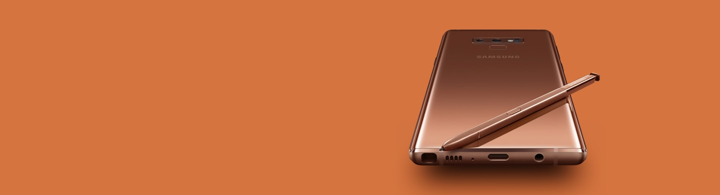 Metallic Copper Galaxy Note9 laying screen-down with copper S Pen on top, viewed from the bottom