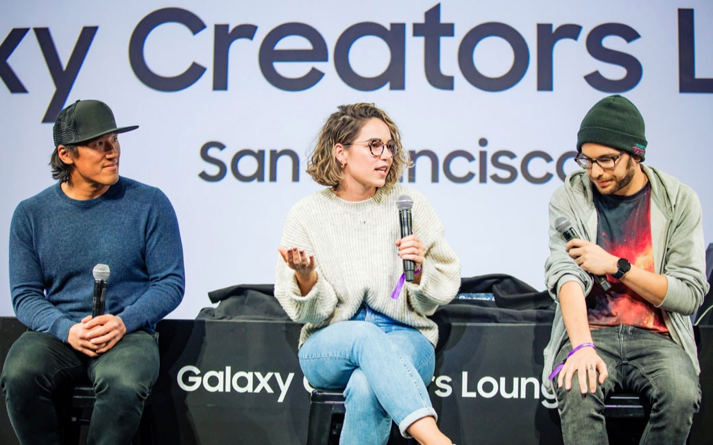 #TeamGalaxy members Jimmy Chin, Iz Harris and Jake Roper on the stage at Creators Lounge during the Creators Talk, Iz Harris is in the middle and has the microphone